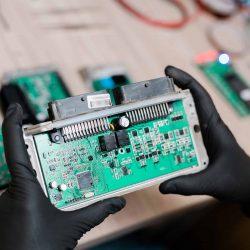 gloved-hands-of-repair-service-master-examining-FUPYQK9
